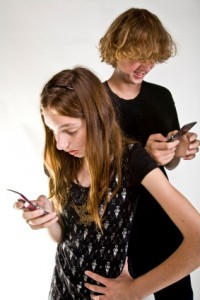Teens Texting Their Fingers to the Bone